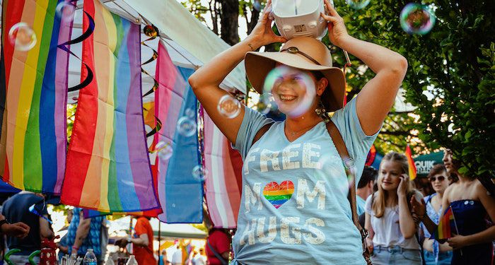 Pride photo of smiling person with bubble machine