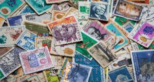 a pile of used stamps