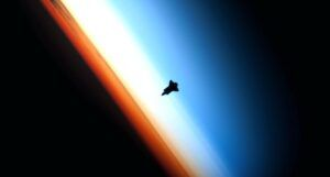 shuttle orbiting above earth's atmosphere https://unsplash.com/photos/7Cz6bWjdlDs