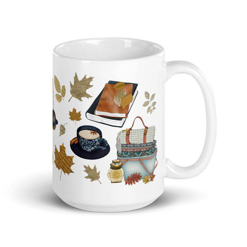 Image of white mug with cats, scarves, and books.