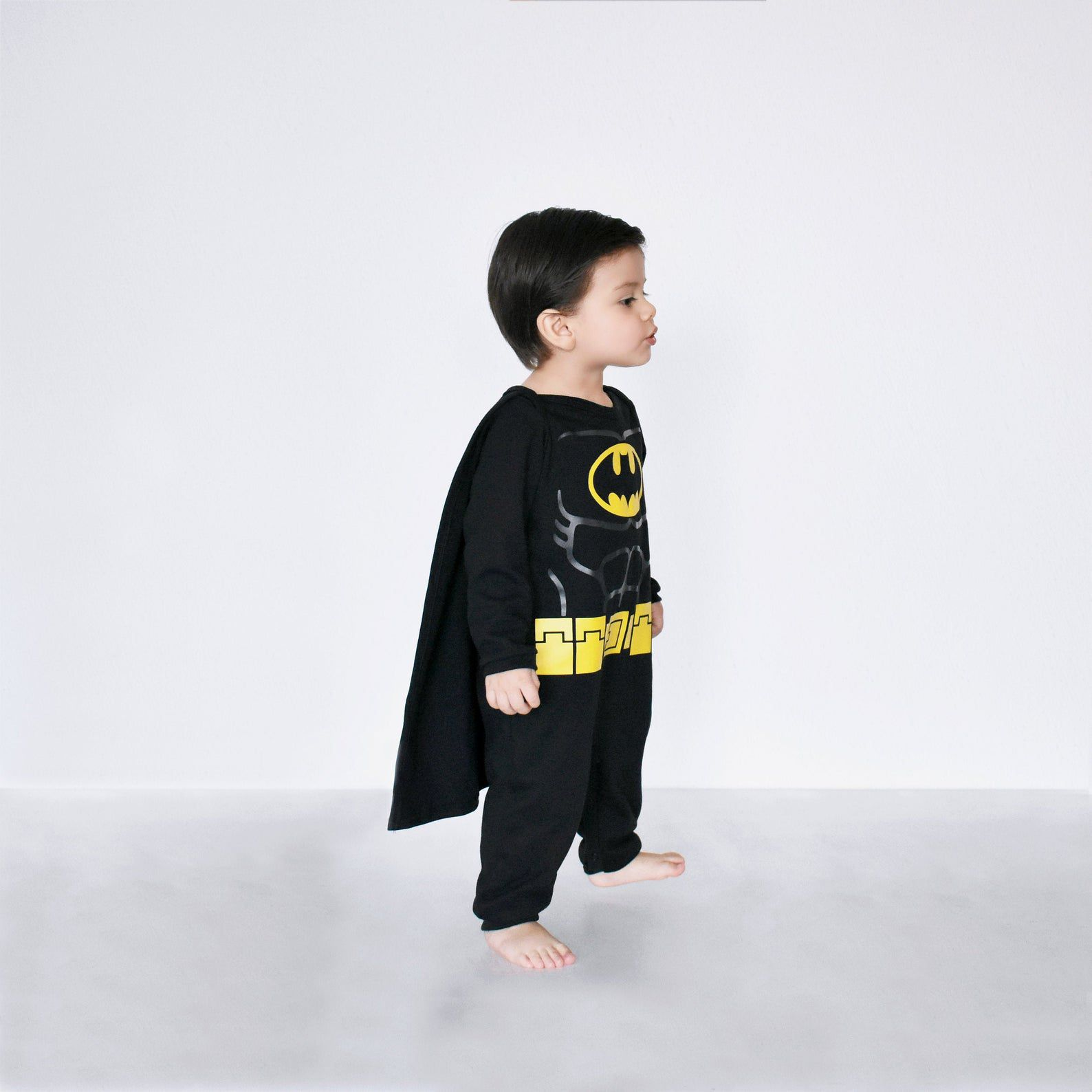 Image of a child in a Batman costume.