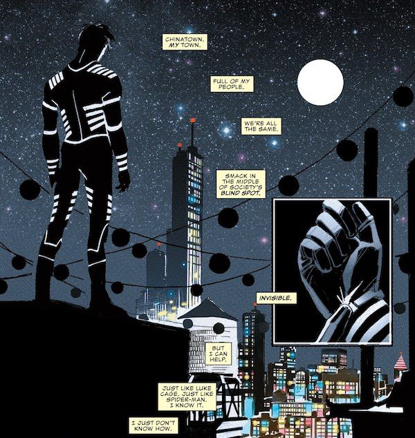 """Two panels from All-New, All-Different Marvel Point One #1. Blindspot stands on a roof in costume, facing away from us and looking out over Chinatown. In a smaller inset panel, he presses a button on his wrist to turn his suit on.  Narration boxes: """"Chinatown. My town. Full of my people. We're all the same. Smack in the middle of society's blind spot. Invisible. But I can help. Just like Luke Cage. Just like Spider-Man. I know it. I just don't know how."""""""