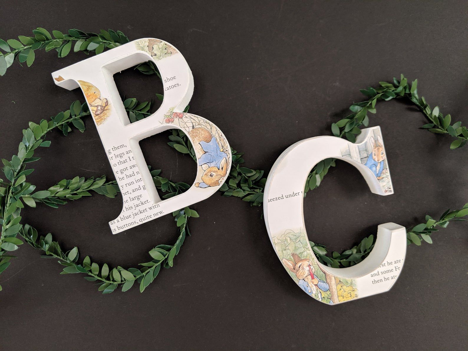 Image of letters B and C with Beatrix Potter designs.