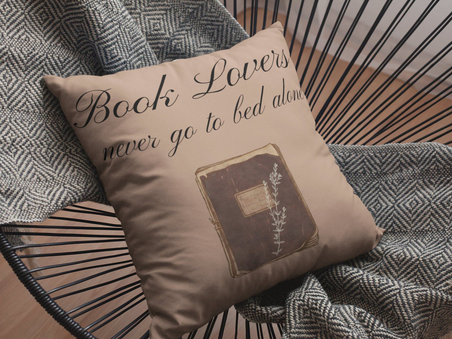 """Image of brown pillow reading """"book lovers never go to bed alone."""""""