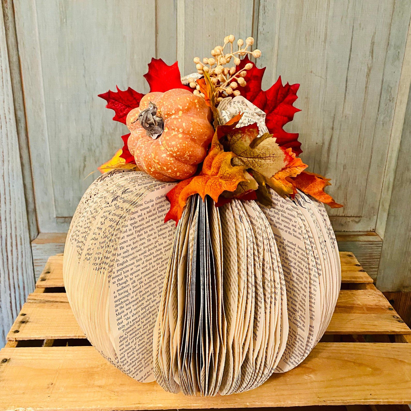 Image of a pumpkin made of book pages.