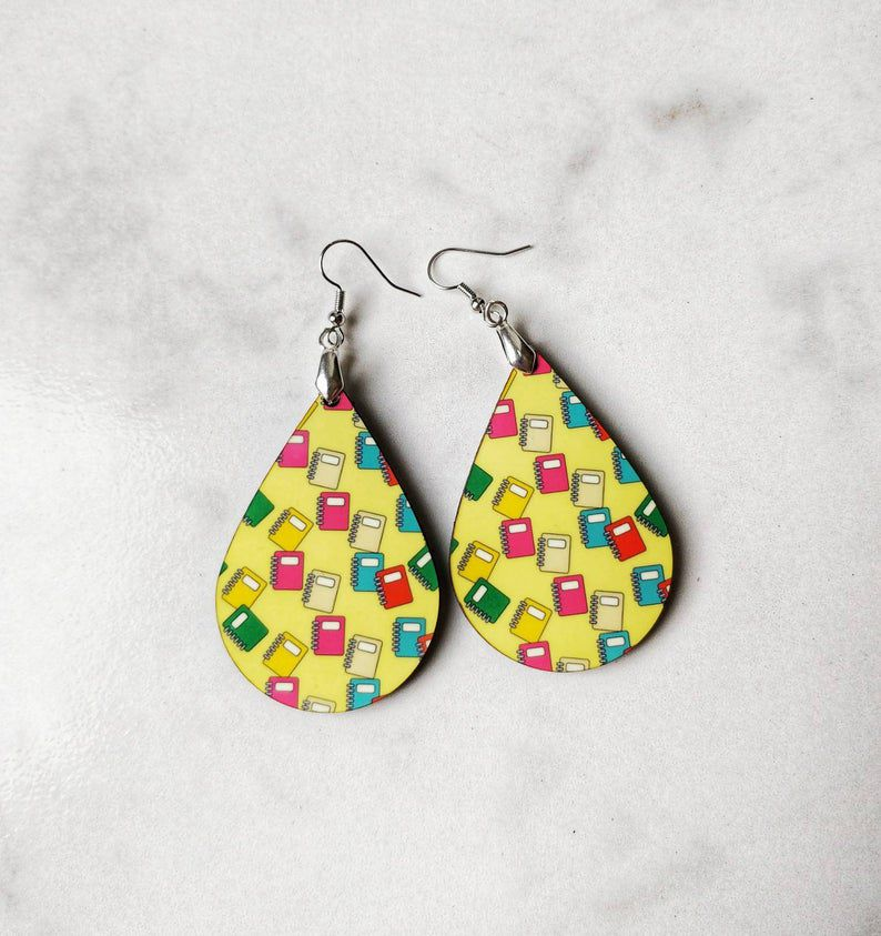 teardrop shaped earrings with colorful books