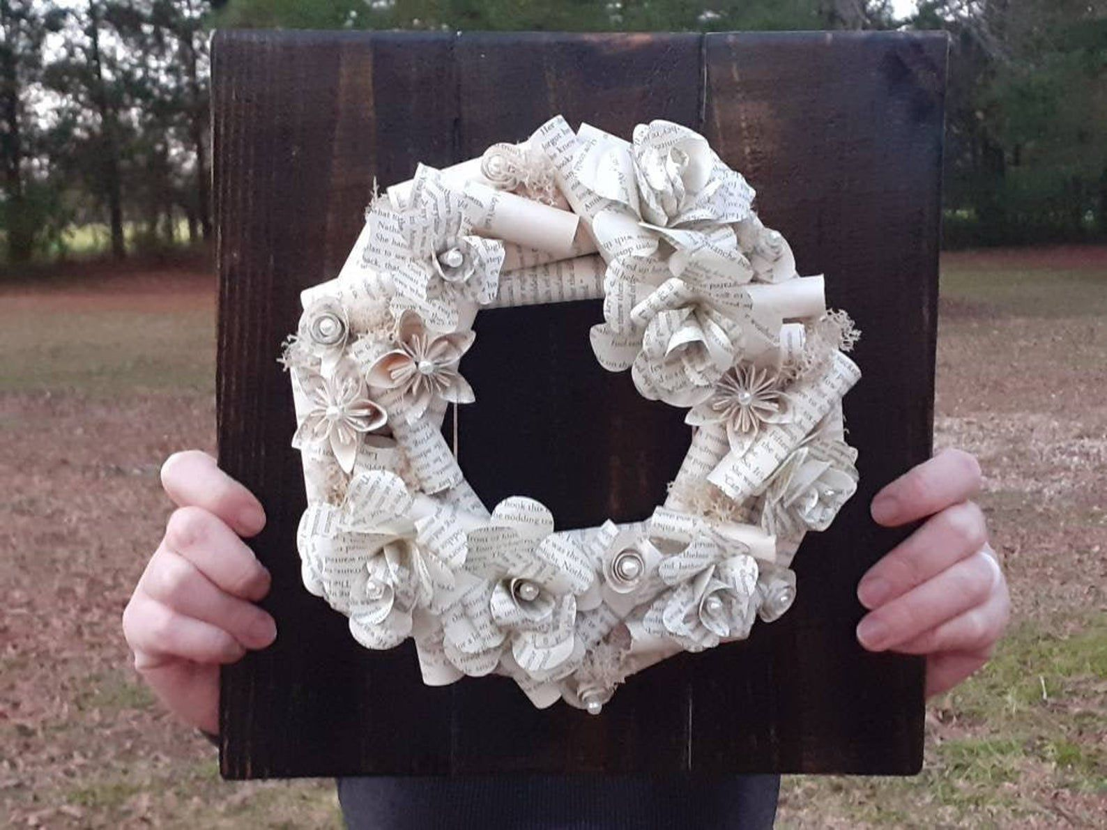 Image of a wreath made of book pages.