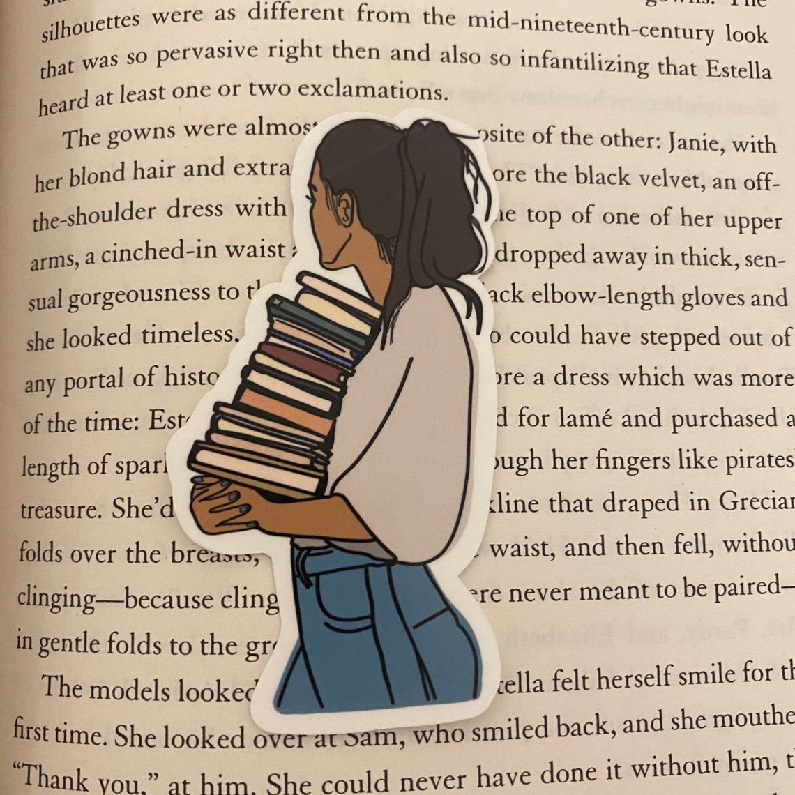 sticker depicting a person looking away over their shoulder holding a stack of books