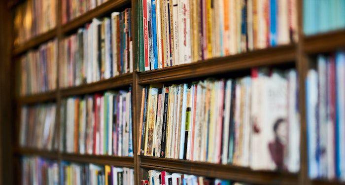 bookshelves of used paperbacks
