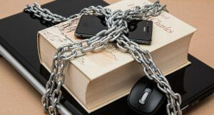 chained book and laptop