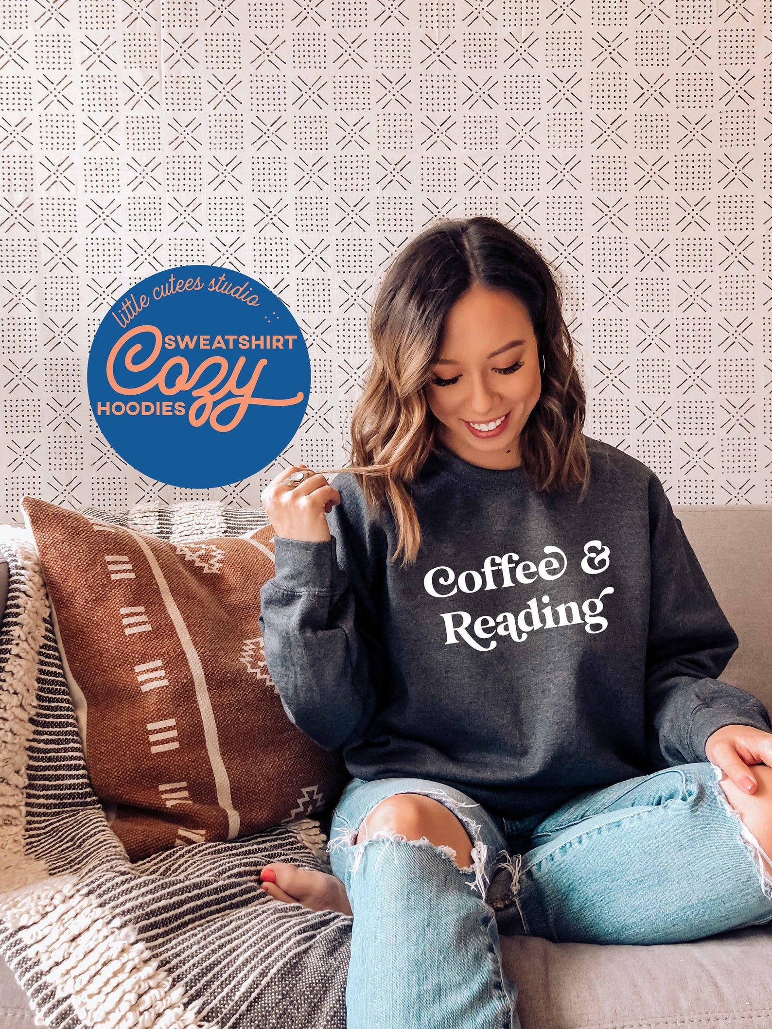 """Image of a person in a gray sweatshirt reading  """"coffee & reading"""""""