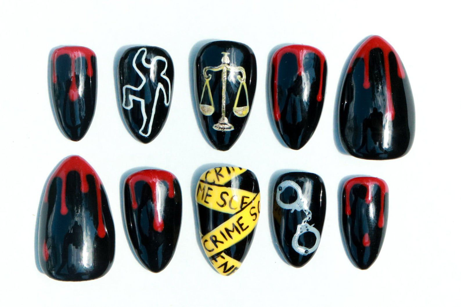 Image of crime nails, including crime scene tape, handcuffs, and blood.