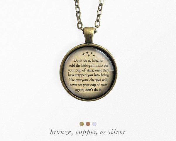 round pendant necklace with text from the haunting of hill house