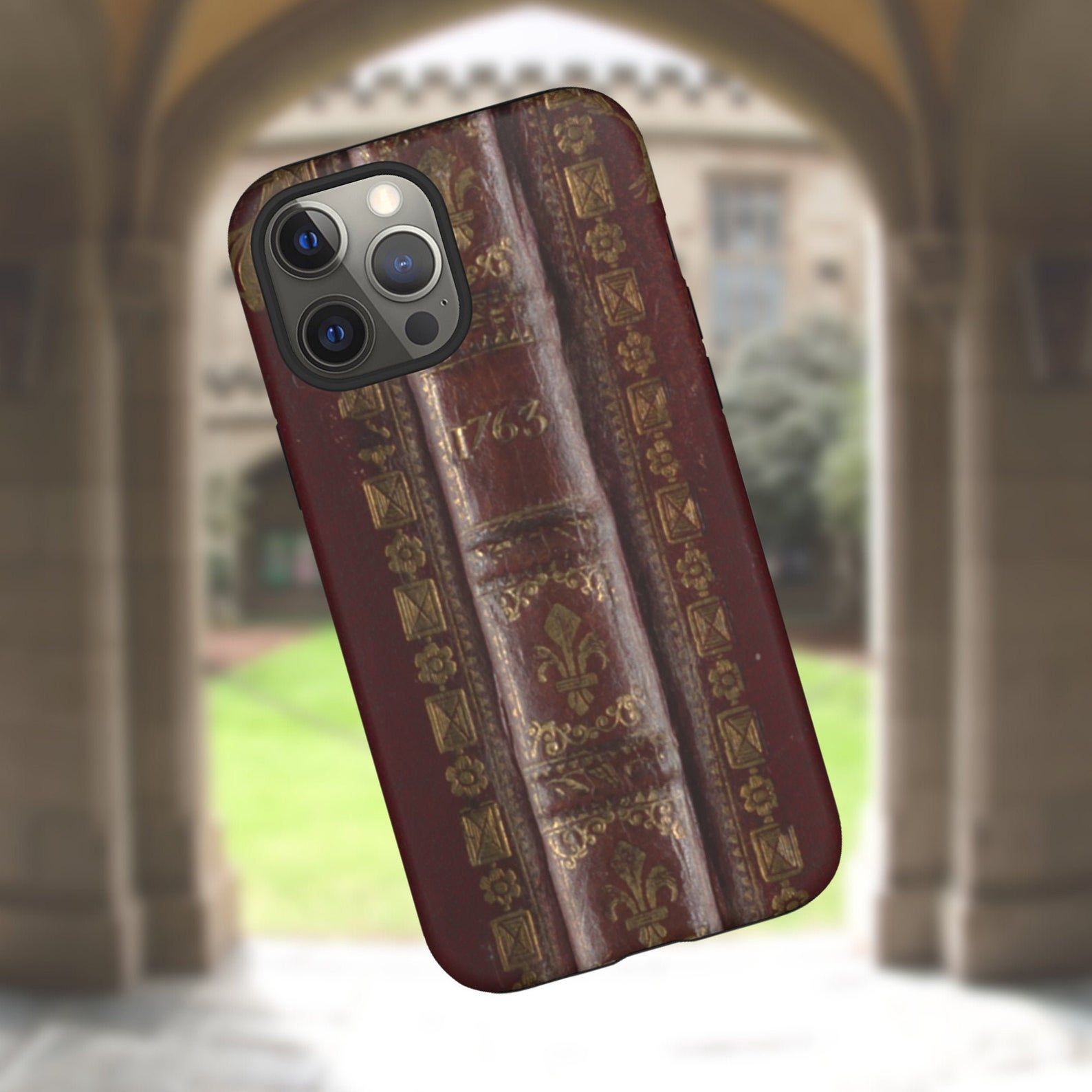 Image of a phone case featuring an old book spine design.