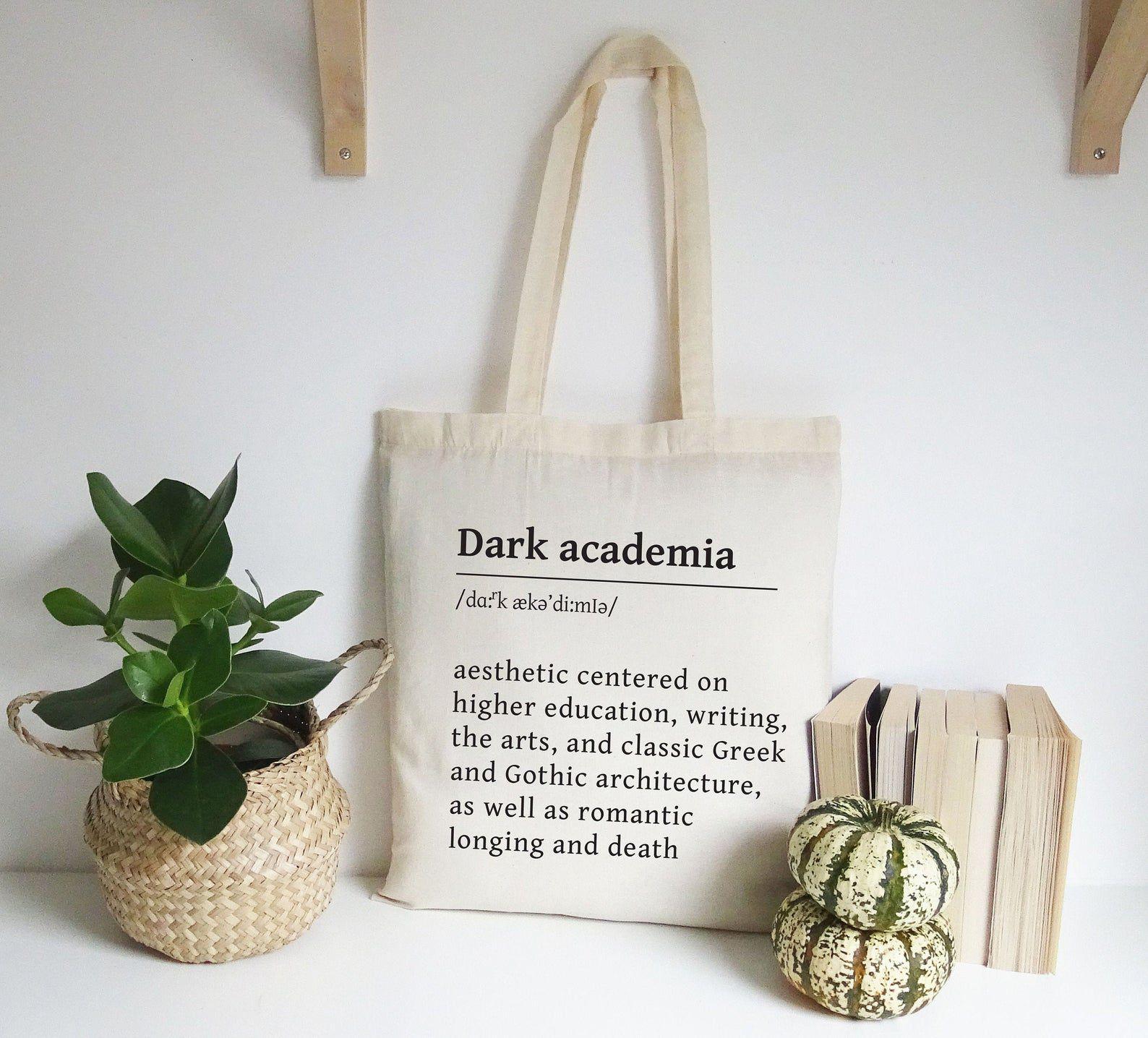 "Image of a cream colored tote defining ""Dark academia."""