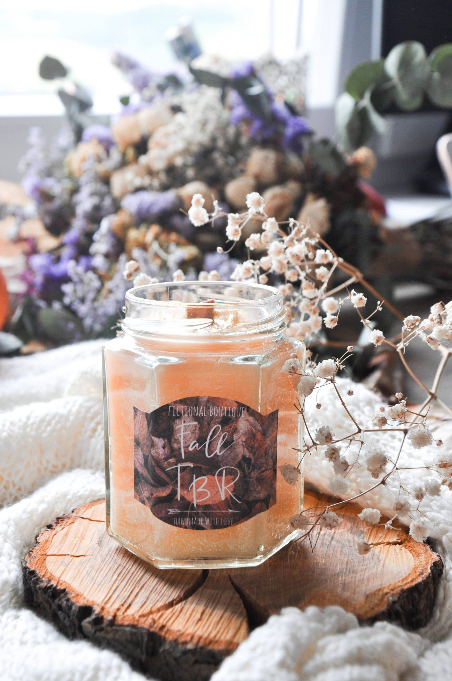 """Image of orange sparkly candle named """"Fall TBR."""""""