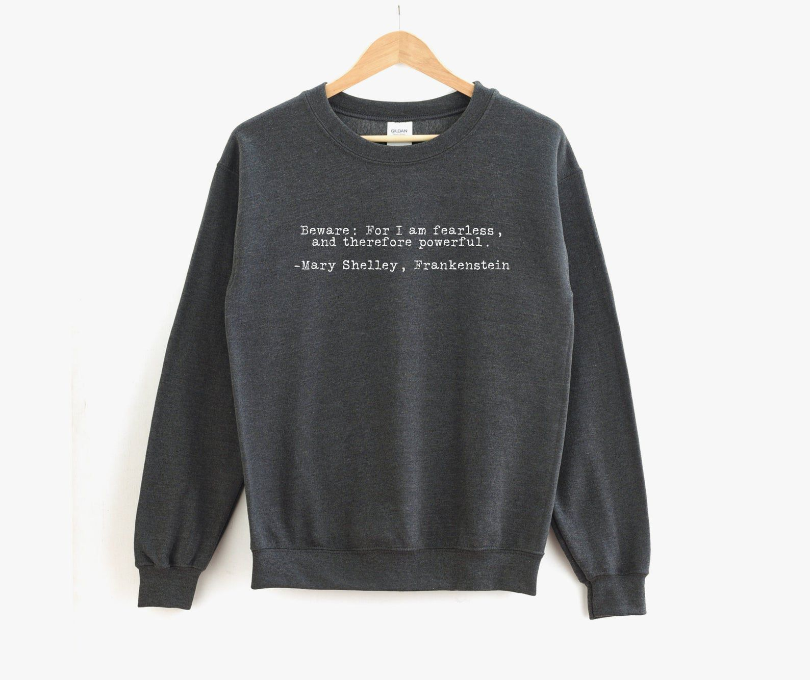 """Image of gray sweatshirt featuring Mary Shelley's Frankenstein quote """"Beware; for I am fearless, and therefore powerful."""""""