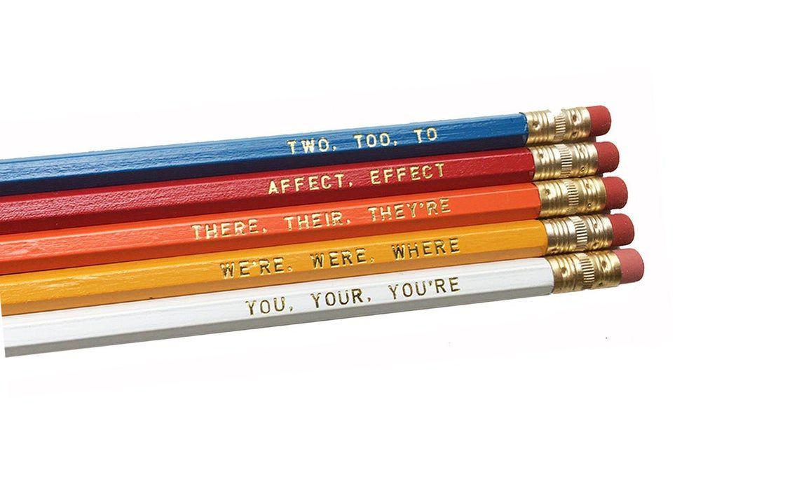 set of five color pencils with grammar reminders