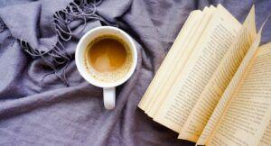 open book next to a coffee mug https://unsplash.com/photos/kRhISEQKWjI