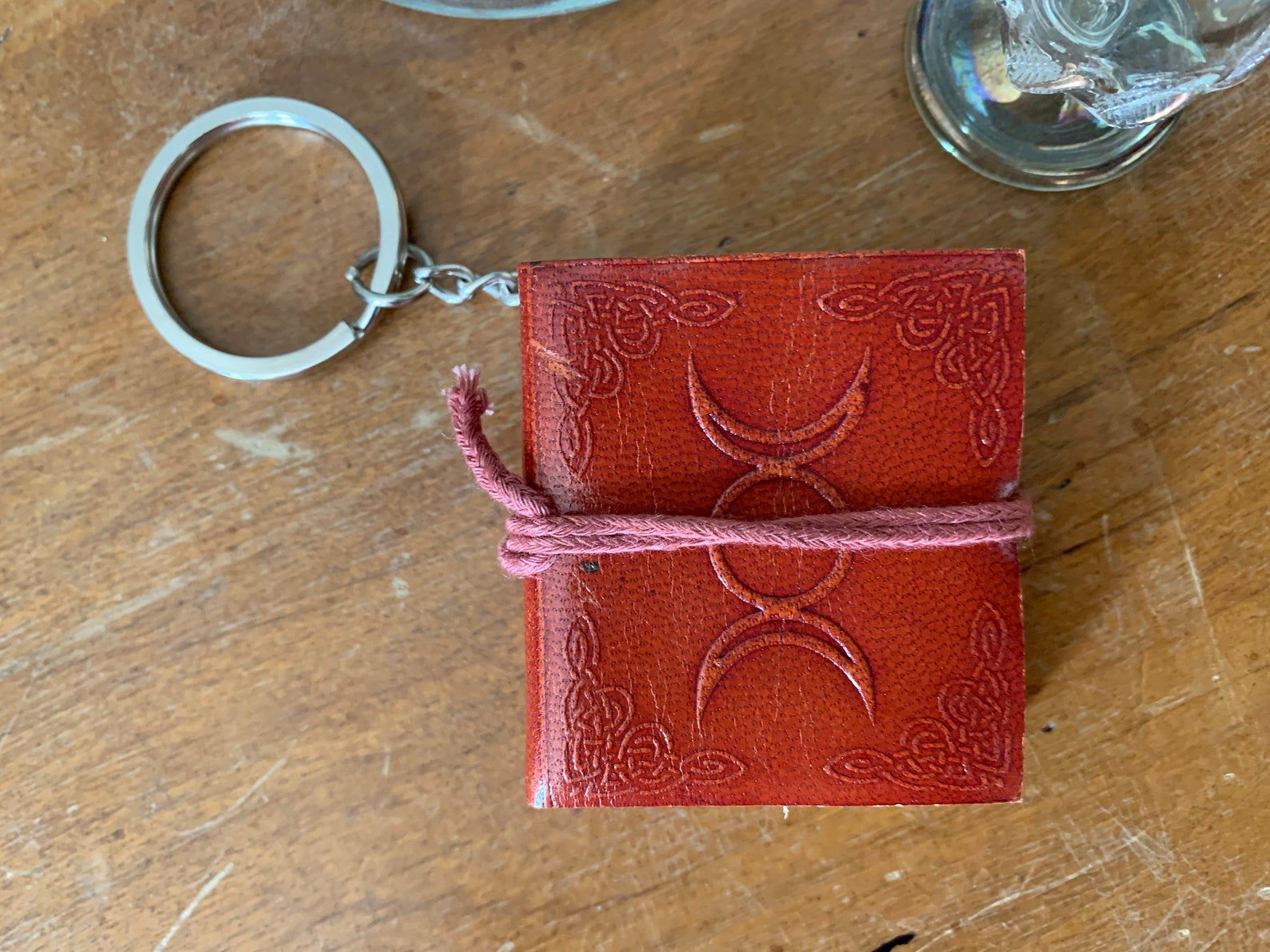 Image of small red journal on a keychain.