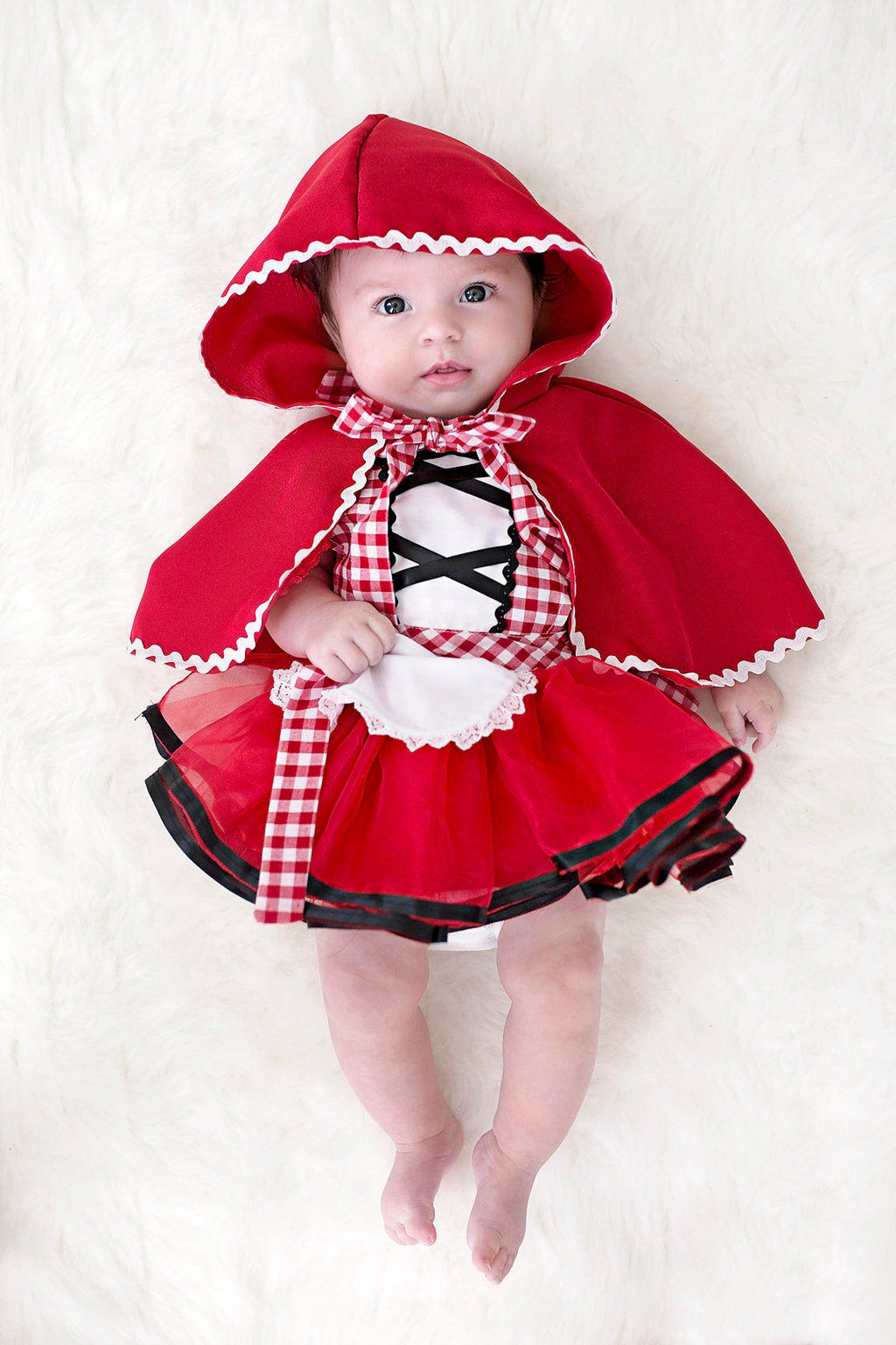 Image of a baby in a Little Red Riding Hood costume.
