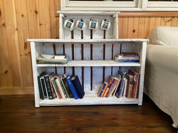 White reclaimed wood bookcase with hooks for mugs