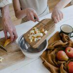 two people making apple pie