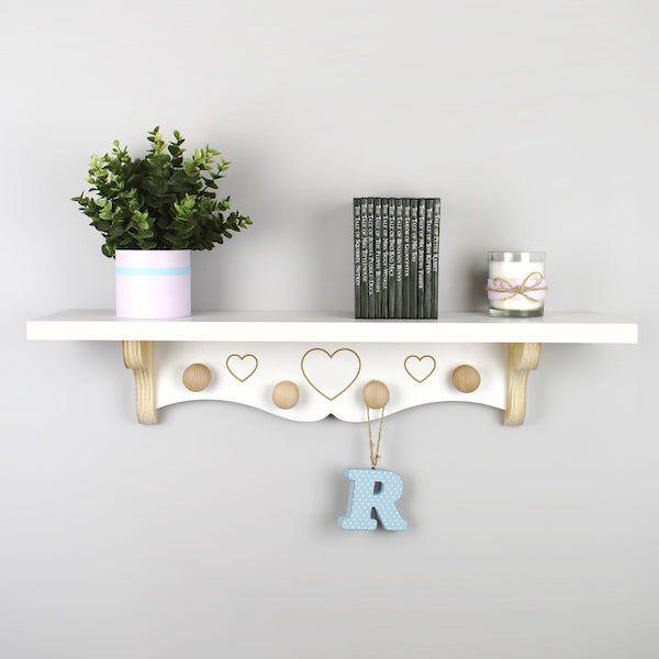 image of white nursery wall bookshelf with hanging pegs