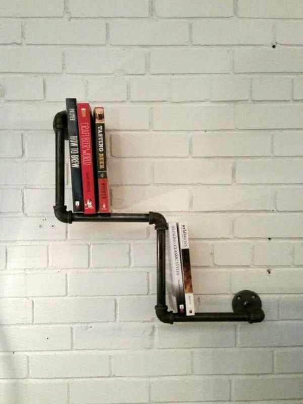 Two-layered book rack made of industrial pipes