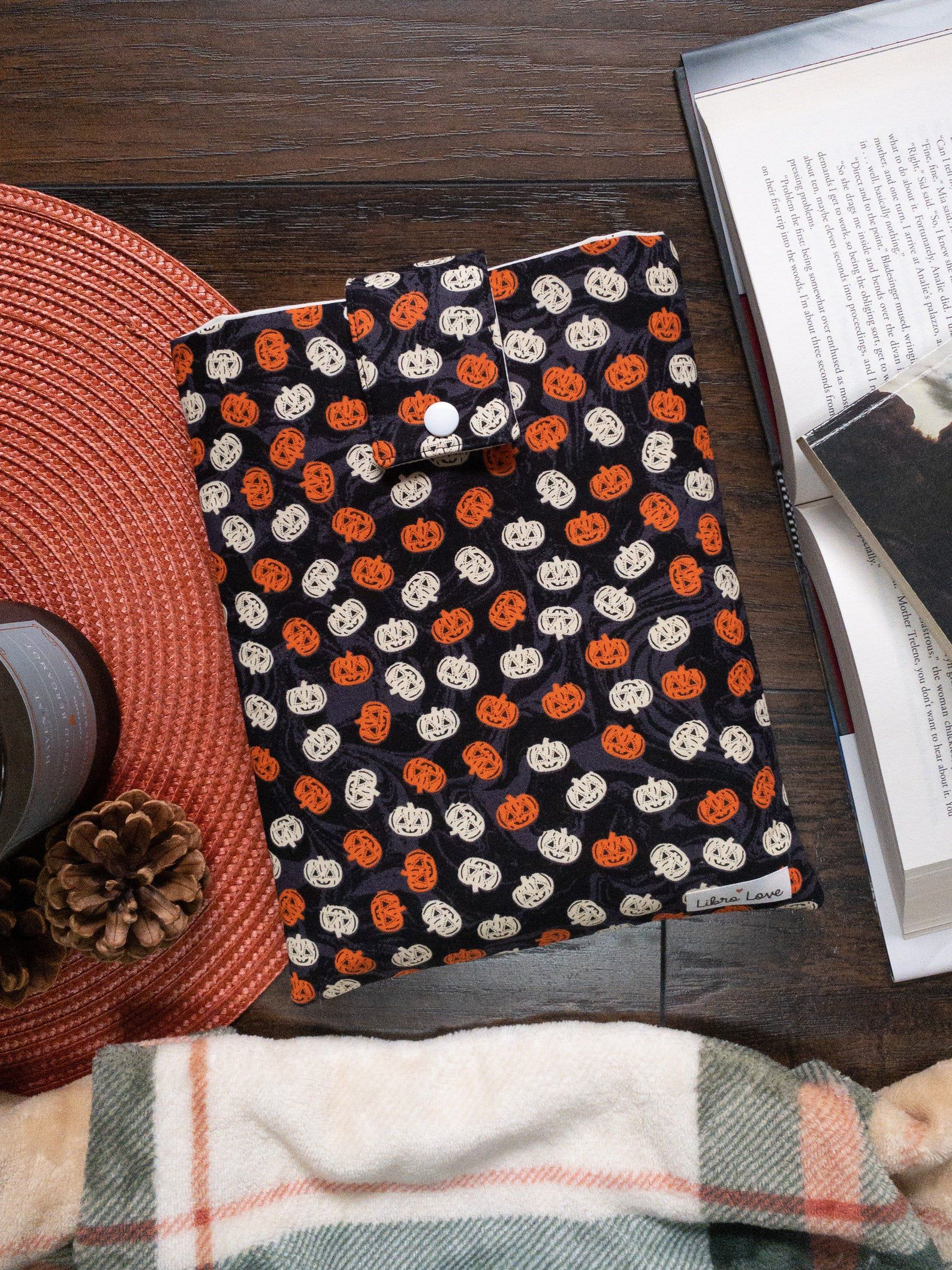 Image of black book sleeve dotted in orange and white pumpkins.