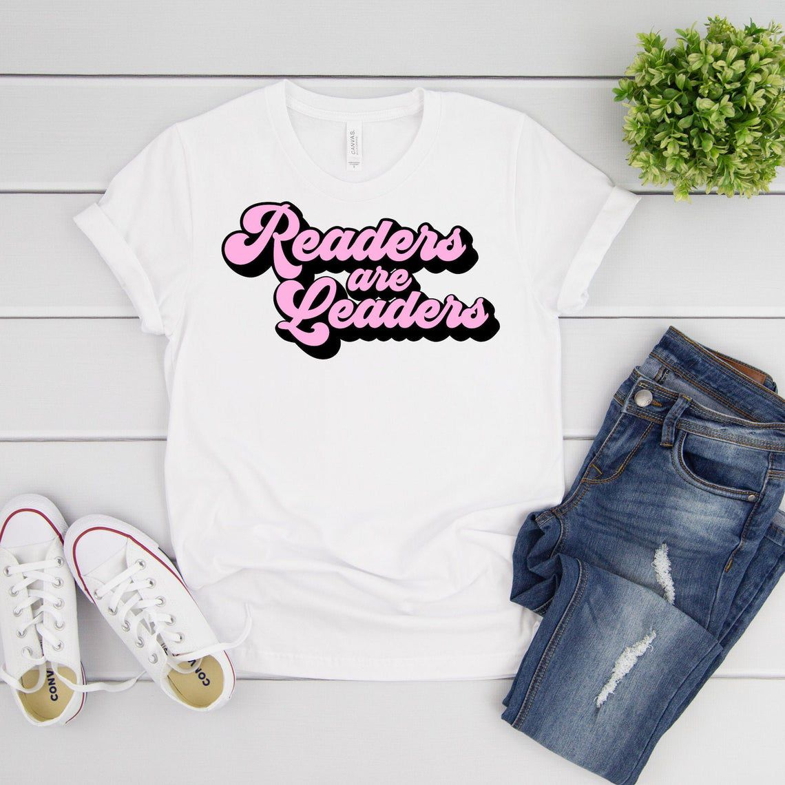 shirt with bubble letters spelling readers are leaders