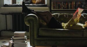reading books on a couch
