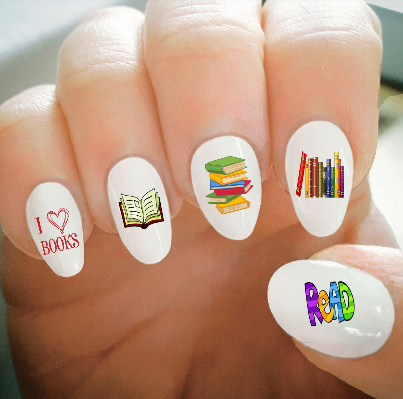 """Image of white nail decals reading """"I love books"""" and """"read."""""""