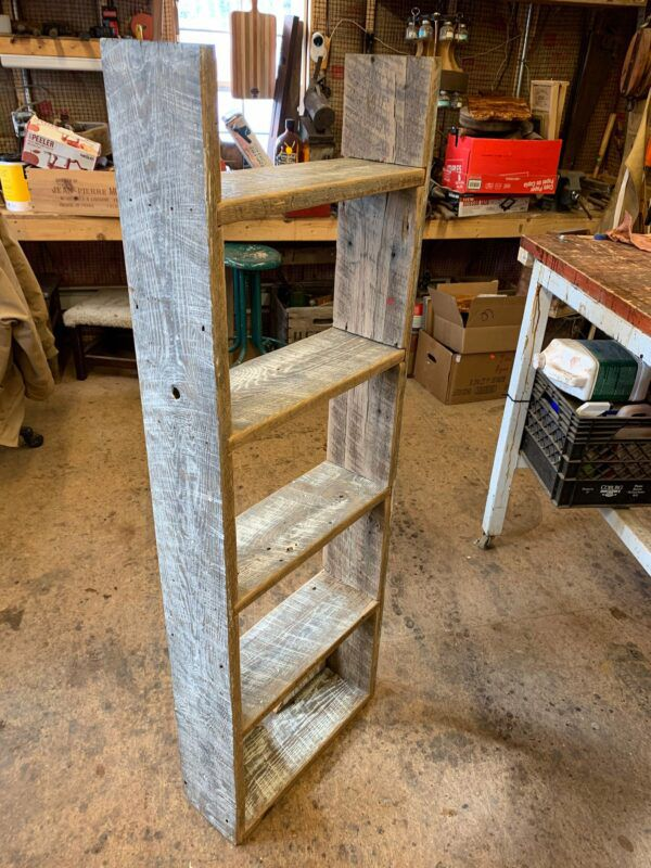 Simple, tall narrow bookcase made from reclaimed barn wood