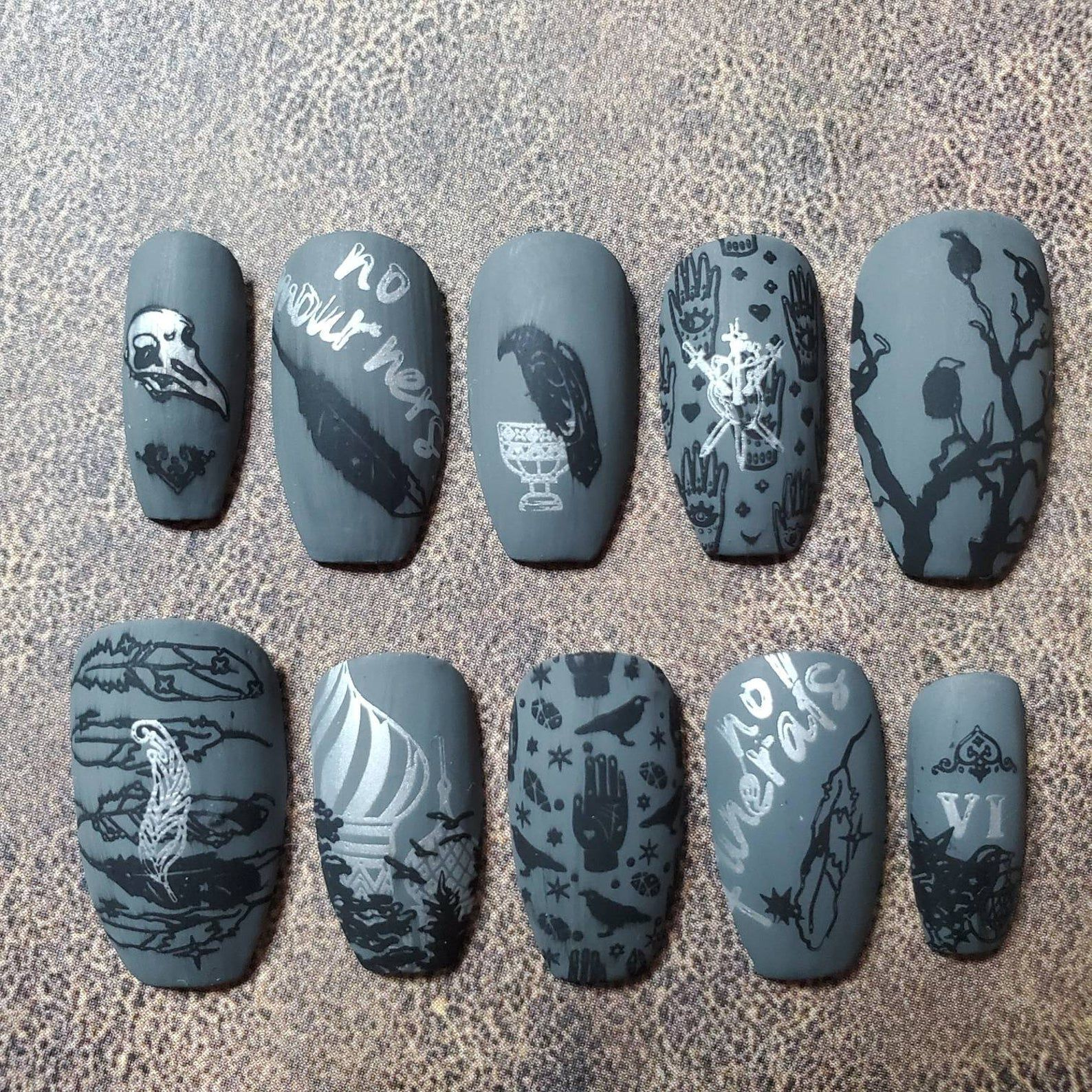 Image of nails featuring symbols and words from SIX OF CROWS