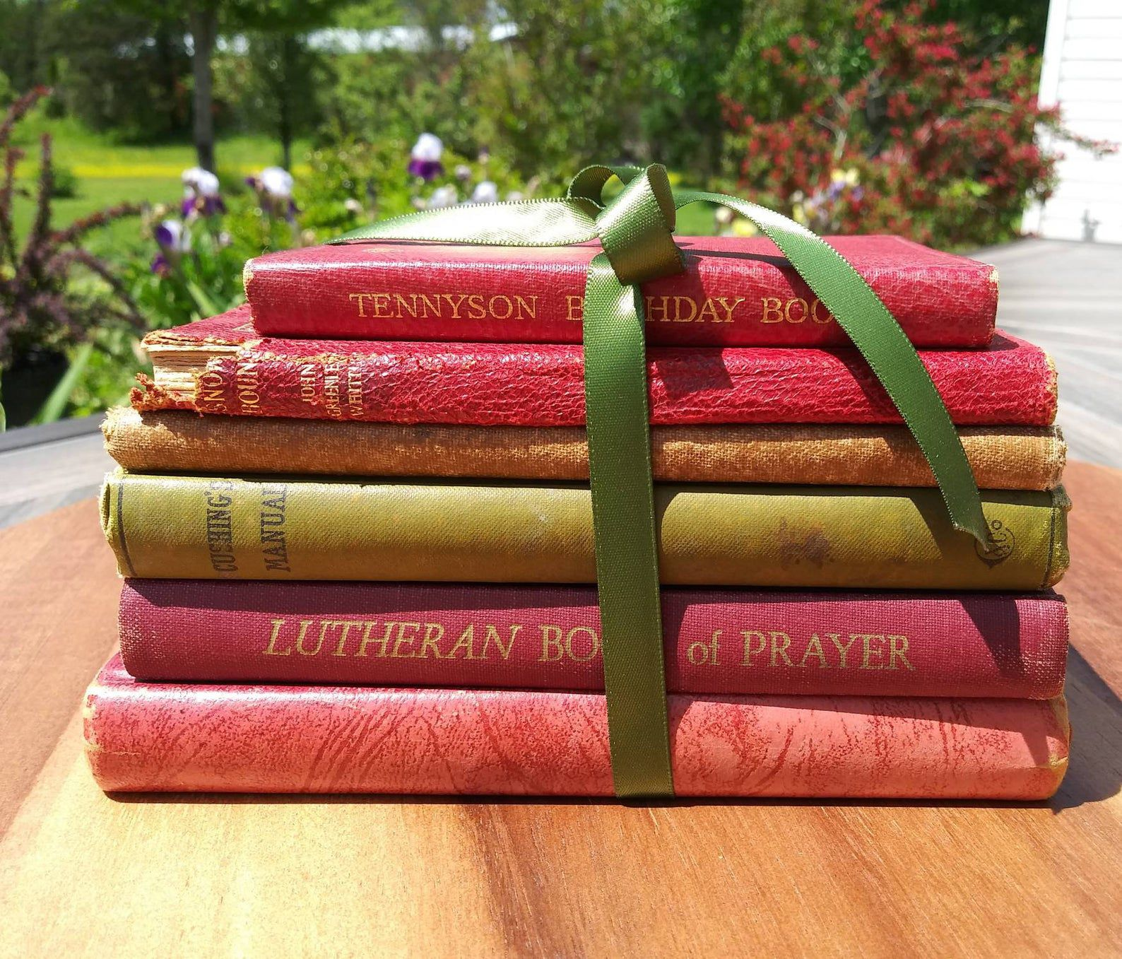 Image of a stack of red and yellow-green books.