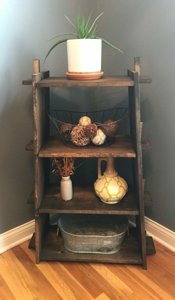 Small wooden bookcase filled with knickknacks