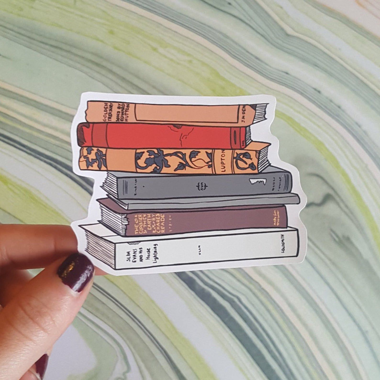 Image of a sticker with fall-colored book spines.