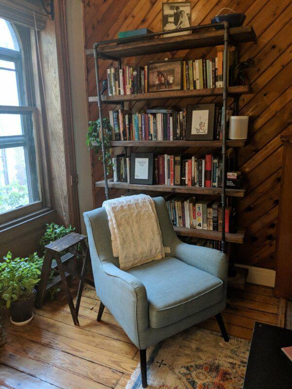 Tall open-sided reclaimed wood bookshelf