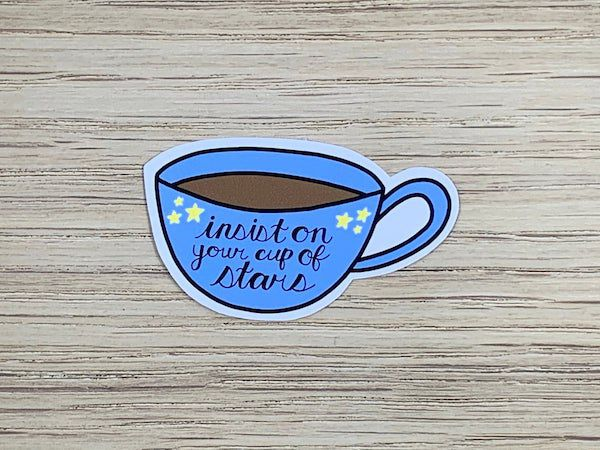 a blue teacup with the words insist on your cup of stars