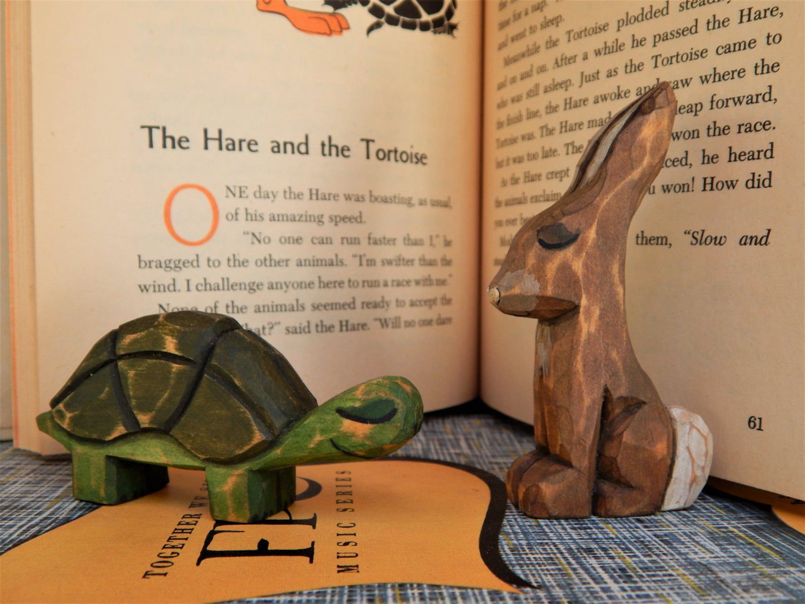 Image of wooden tortoise and hare.