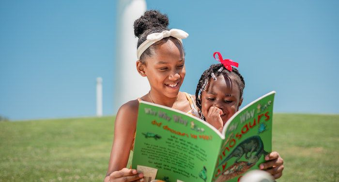 two Black girls reading together