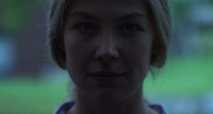 a closeup shot of Rosamund Pike in the foilm adaptation of Gone Girl https://www.imdb.com/title/tt2267998/mediaviewer/rm3840629760/