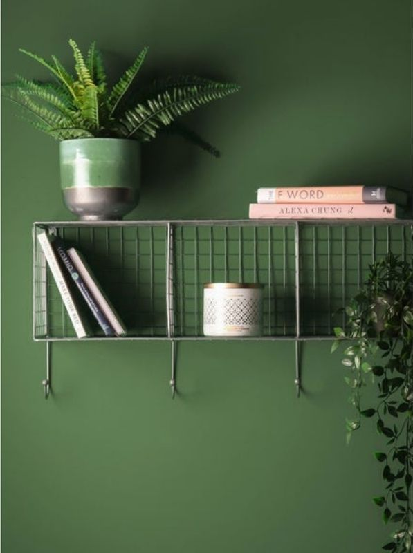 Horizontal wire rack with three compartments and four hooks along bottom