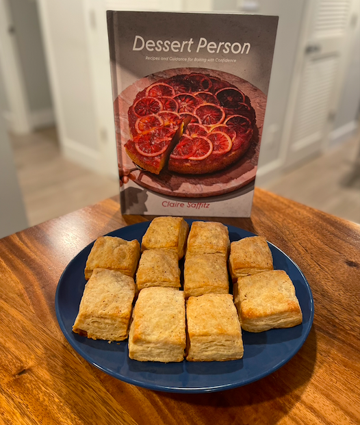 Dessert Person cookbook with plate of buttermilk biscuits