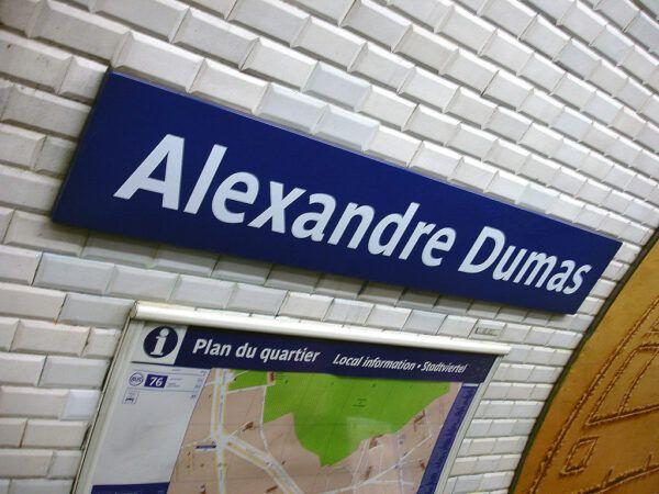 A sign reading Alexandre Dumas at a Paris metro station
