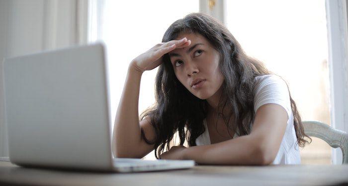 annoyed woman on laptop