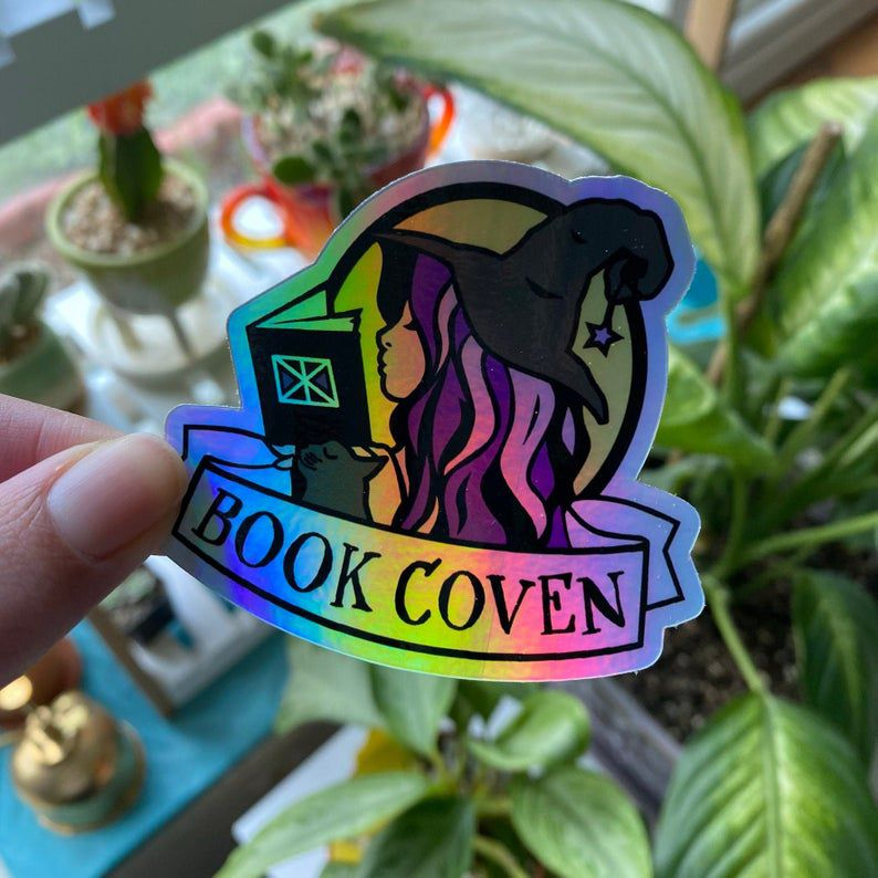 Shiny book coven sticker.