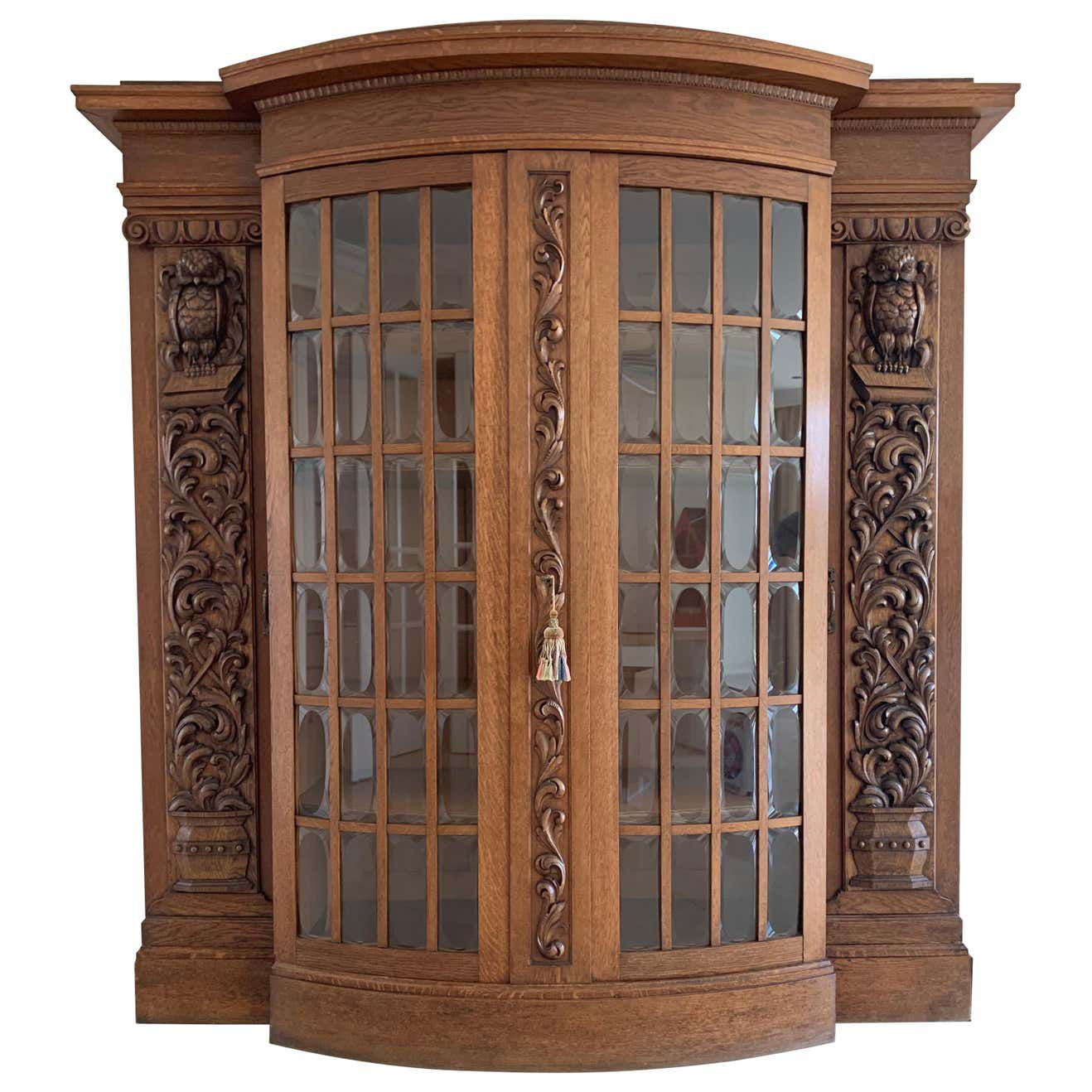 bookcase with owl carvings