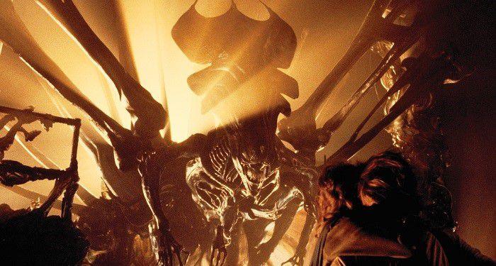 still frame from movie Alien (1986) showing the alien in yellow light